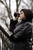 Woman with lens — Stockfoto