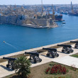 View to Grand Harbour of Valetta and medieval cannons battery — Stock Photo