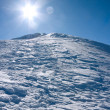 Stock Photo: Winter mountains landscape against sun