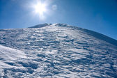 Winter mountains landscape against the sun — Stock Photo