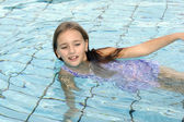 Princess Elena in swimming pool — Stock Photo