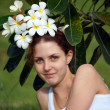 Stock Photo: Girl with natural flowers.