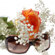 Royalty-Free Stock Photo: Sun glasses and bunch of flowers