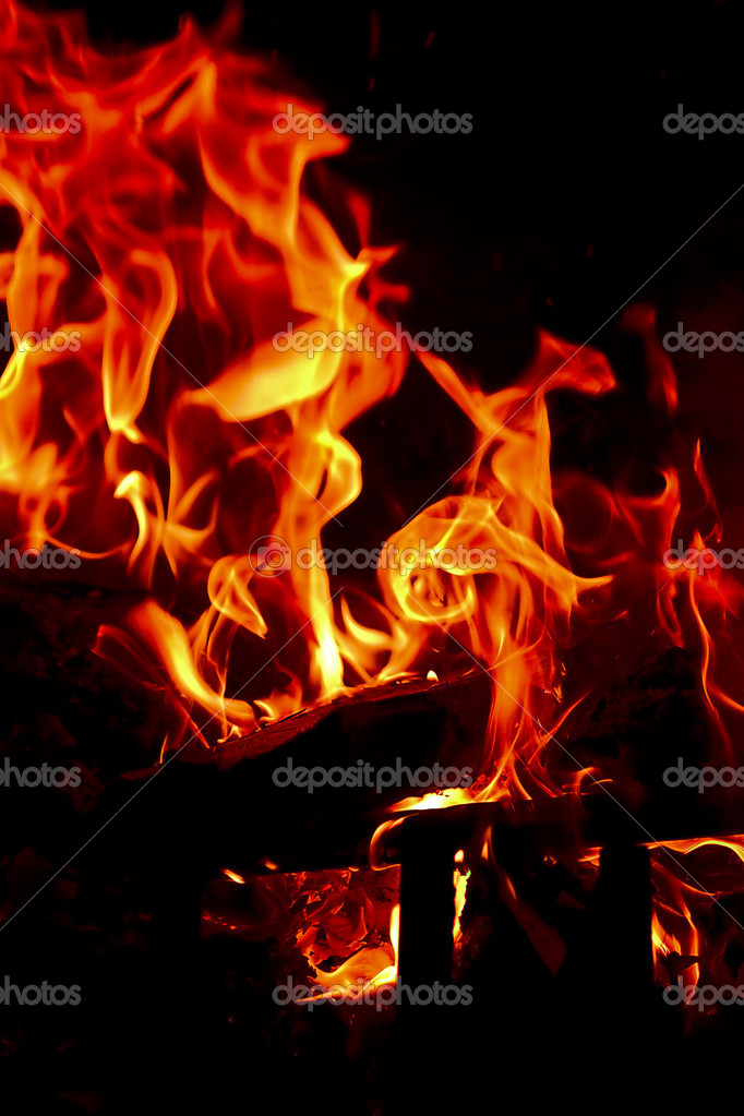 Flames Fire of Hell against a black background.   Stock Photo #2784499