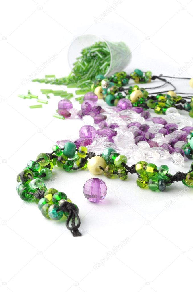 Heap of colored glass beads with metal fittings  Stock Photo #3030441