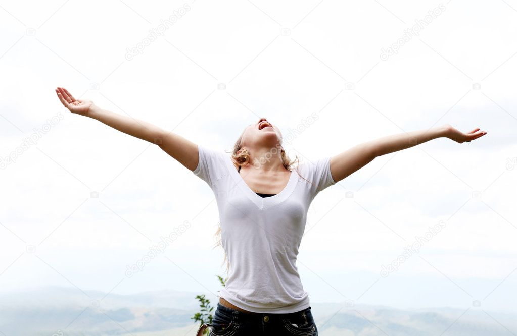 Young woman with outstretched arms expressing freedom  Stock Photo #2865934