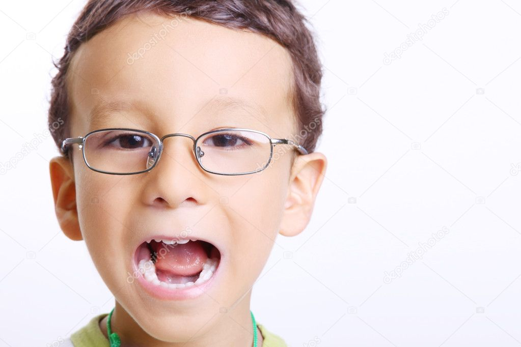 Child smiling with his mouth open and looking at the camera  Stock Photo #3108241