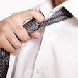 Tie and hand — Stock Photo