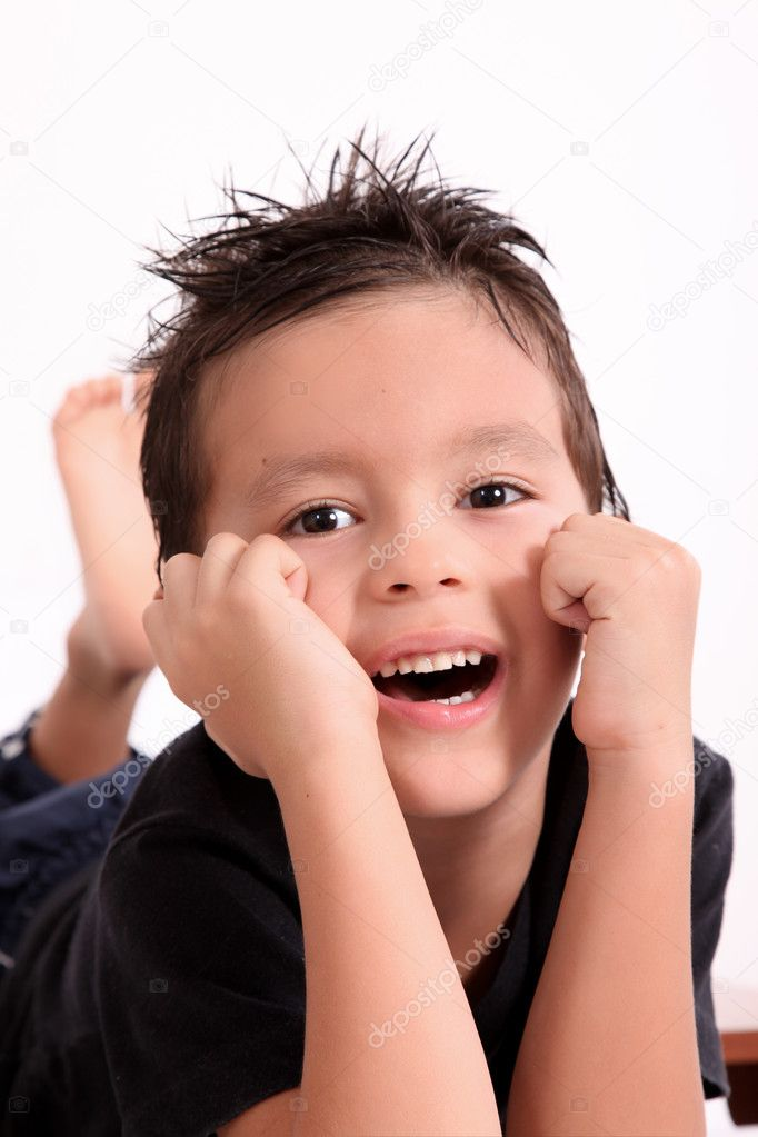 Child smiling and looking at the camera, White background — Stock Photo #3833546