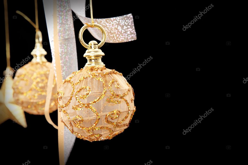 Golden christmas ball on black background, space to insert text or design — Stock Photo #4152909
