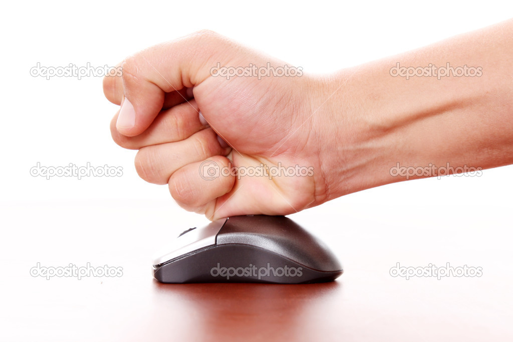 Hand hitting a computer mouse over white background. Concept stress   Stock Photo #4322491