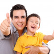 Father and son having fun with a wave of positivism — Stock Photo #4867163