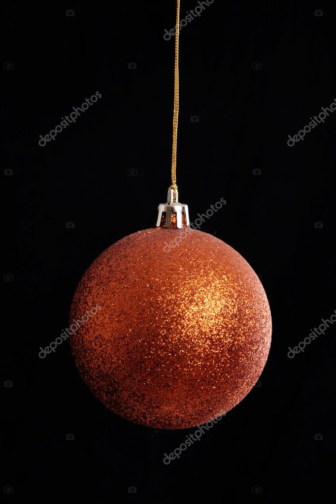 Orange christmas ball hanging on black background — Photo #4865818