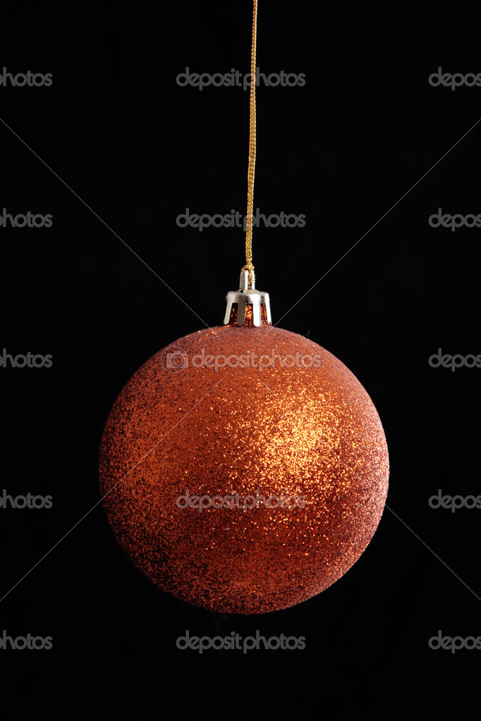 Orange christmas ball hanging on black background — Stok fotoğraf #4865818