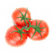 Three tomatoes with water drops — Stock Photo