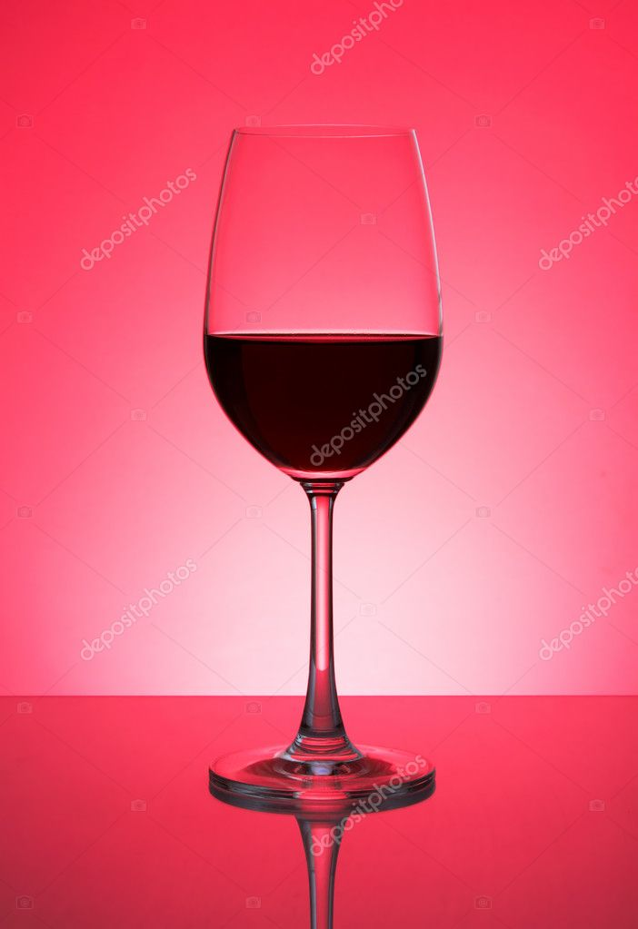 Glass with red wine on a red background — Stock Photo #2792285