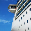 Stock Photo: Luxury white cruise ship on blue sky
