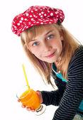 Girl-drinking orange juice. — Stock Photo