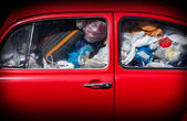 A red car with rubbish. — Stock Photo
