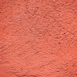 Red colored plaster wall background — Stock Photo