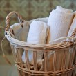 Stock Photo: Two white rolled towels in wicker basket