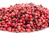 Heap of pink pepper in corns closeup — Stock Photo