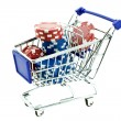 Color poker chips in shopping trolley — Stock Photo