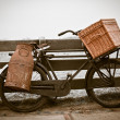 Old bicycle with can and basket - Stock Photo