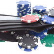 Multicolor poker chips in black leather wallet — Stock Photo