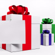 White gift boxes with red ribbon 3d — Stock Photo