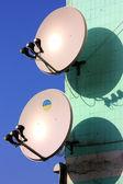TV antenna on green building — Stock Photo