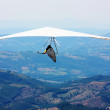 Hang glider flying in the mountains - Stok fotoğraf