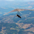 Hang glider flying in mountains — стоковое фото #3728154