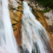 Amazing waterfall in the Alps — Stockfoto
