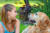 Young girl and her friend a dog — Stock Photo