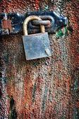 Rusty lock on wooden door — Stock Photo