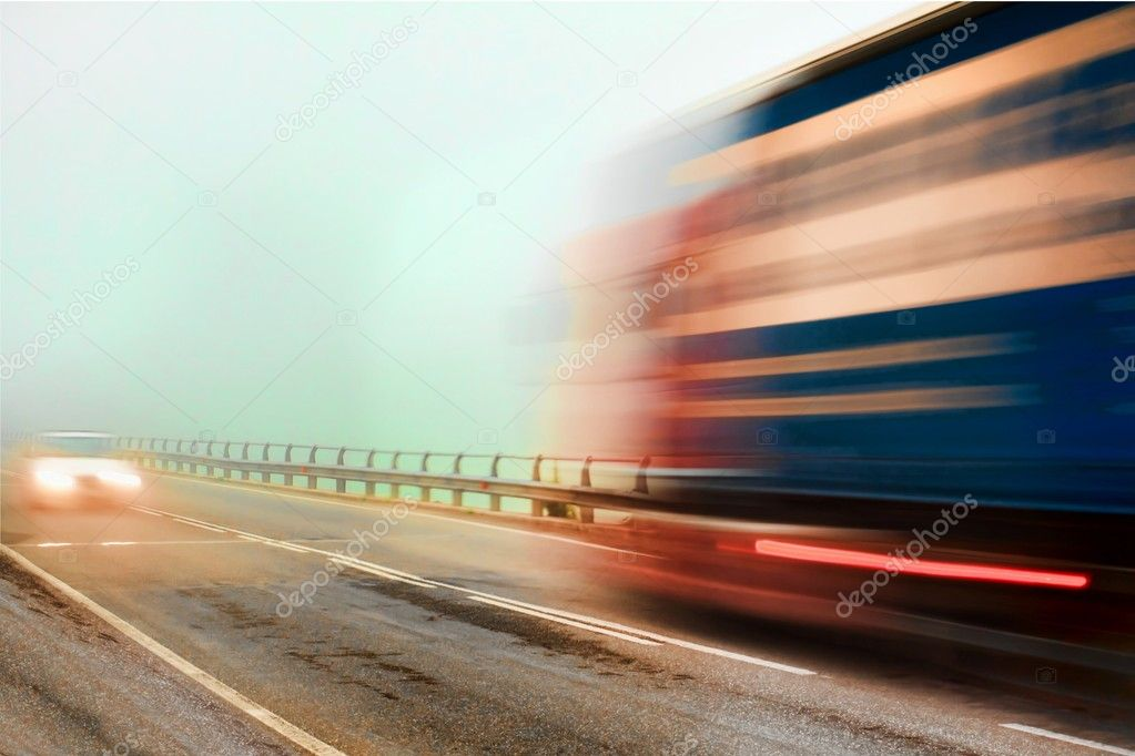 The cars moves at great speed in fog  Stock Photo #3162129