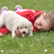 Stock Photo: Little happy girl with puppy