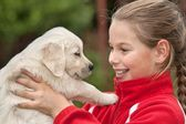 Little happy girl with puppy — Stock Photo