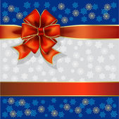 Christmas gift ribbon on a snowflakes background — Vecteur