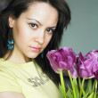 Young woman with bouquet of tulips - Stock Photo