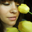 Young woman with bouquet of tulips — Stock Photo #2724008