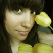 Young woman with bouquet of tulips — Stock Photo