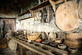 Antiquarian tableware in old kitchen. — Stock Photo