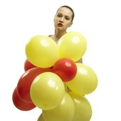 Young pretty woman with balloons — Stock Photo