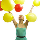 Joyful young woman with balloons — Stock Photo