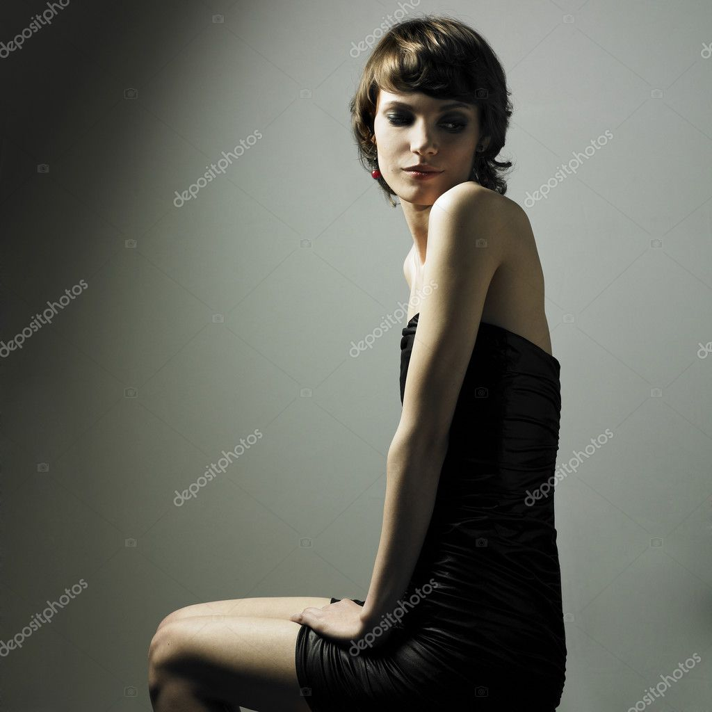 Fashion portrait of young magnificent woman in elegant dress — Stock Photo #2721792