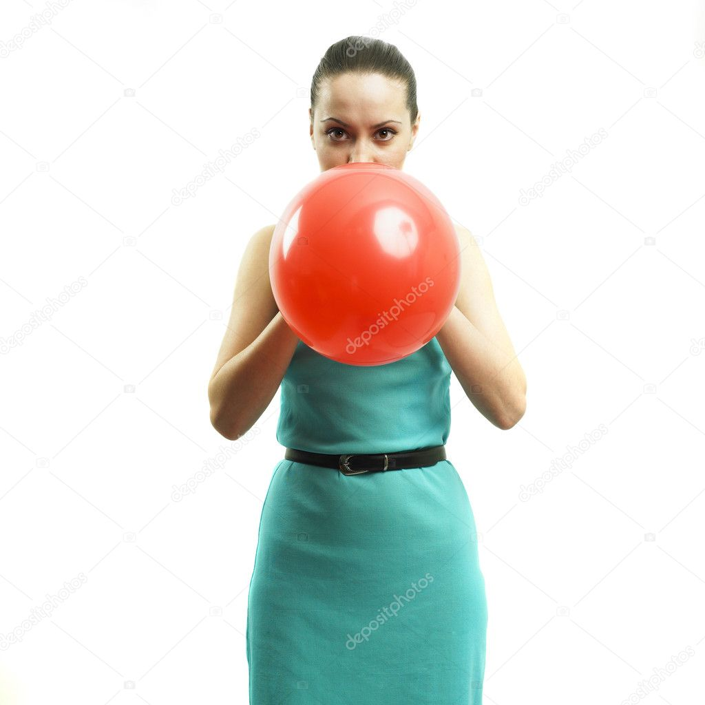 Fashion portrait of young attractive girl inflating a balloon — Stock Photo #2723714