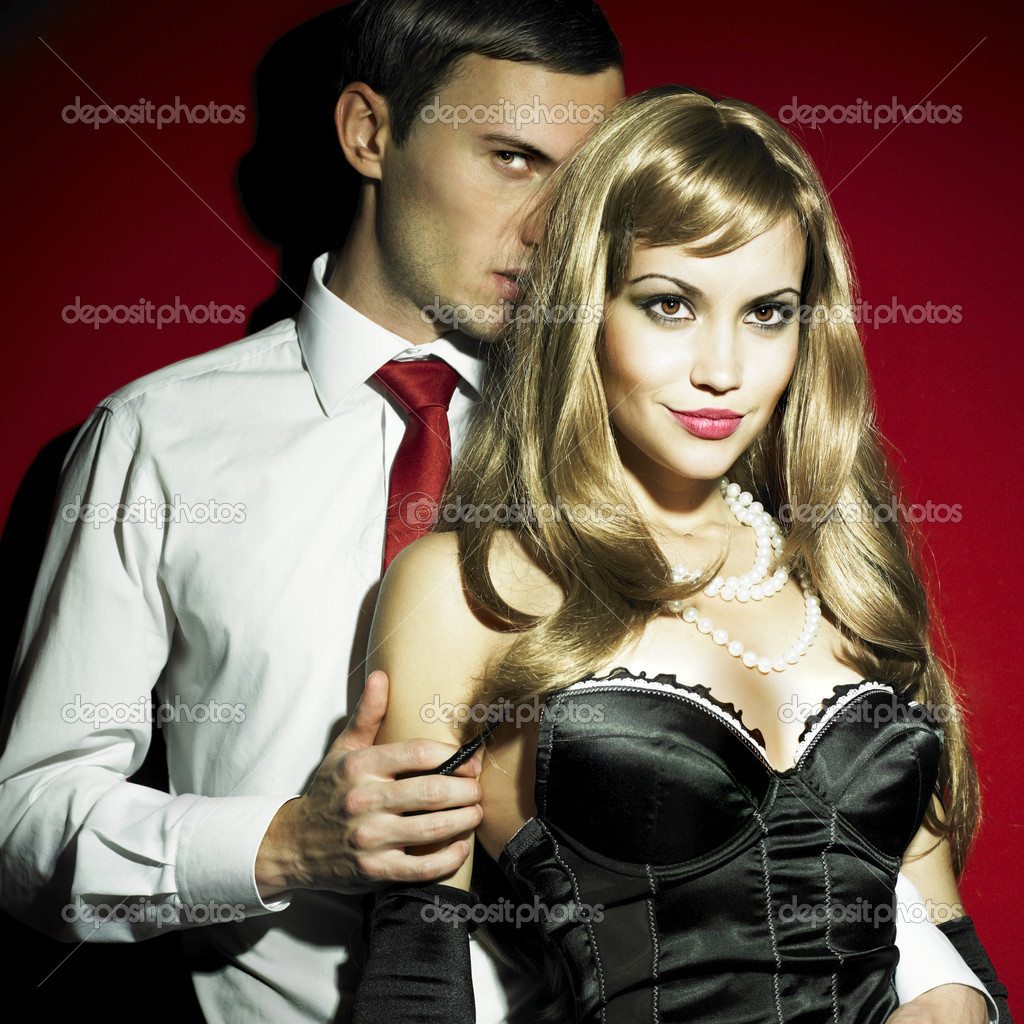 Two young lovers in expensive sexual clothes — Stockfoto #2728556