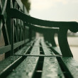 Wet town bench - Stock Photo
